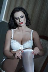 Sensual brunette woman strip