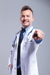 young smiling doctor pointing finger
