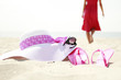 girl with flip-flops on the beach