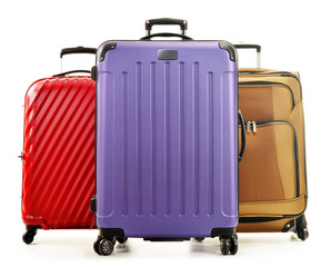 Three large suitcases isolated on white background