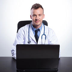 young doctor sitting at his desk