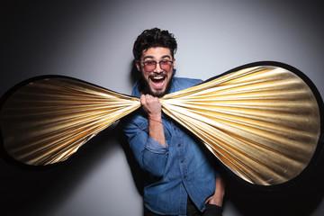 fashion man having fun with a big bow tie