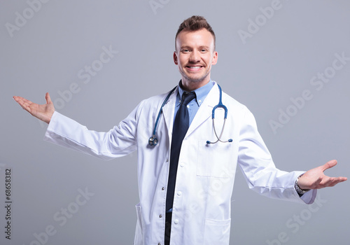 young smiling doctor welcoming you