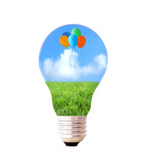light bulb with grass, sky and colorful balloons
