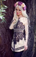 Beautiful blonde model posing in dress