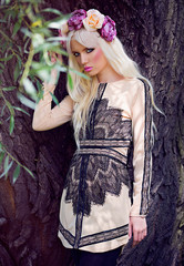 Beautiful blonde girl posing in dress