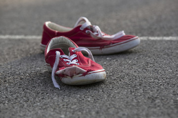 Worn Sneakers On a Basketball Court