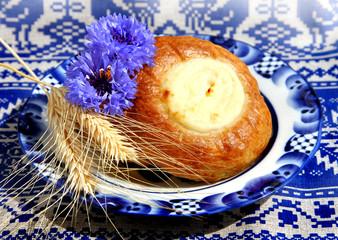Fresh baked curd tart on blue plate