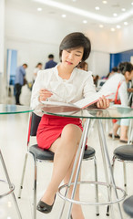 Cute Thai (Asian) businesswoman is reading her document file in