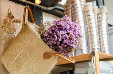 Pink flower in weave basket