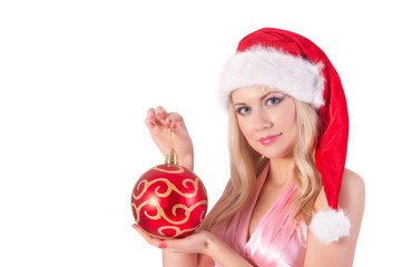 blond woman in santa hat with christmas ball