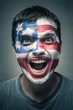 Exited man with US flag painted on face