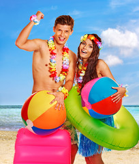 Couple with beach accessories at Hawaii .