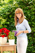Beautiful florist standing in garden. Small business.