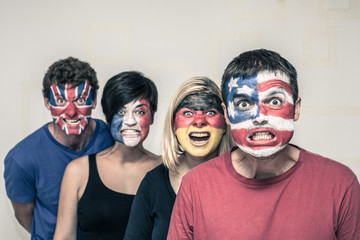 Scary people with flags on faces
