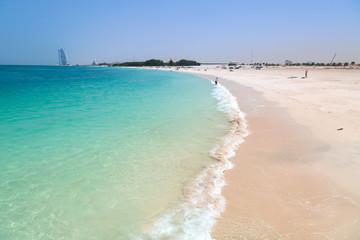 Public beach with turquoise water in Dubai, UAE