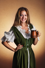 woman in tiroler oktoberfest dress with big mug of beer