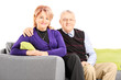 Lovely mature couple sitting on sofa