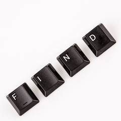 find word written with black computer buttons over white