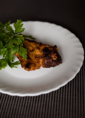 plate with meat and parsley