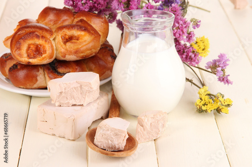 canvas print picture Dry yeast with pastry on wooden table close-up