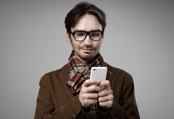 Hipster style man typing on smartphone