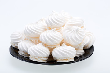 French vanilla meringue cookies on white background