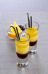 layers in a cocktail glass with orange