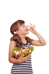 happy little girl with salad and ok hand sign
