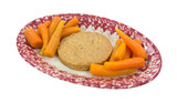 Veggie patty with carrots on oval dish