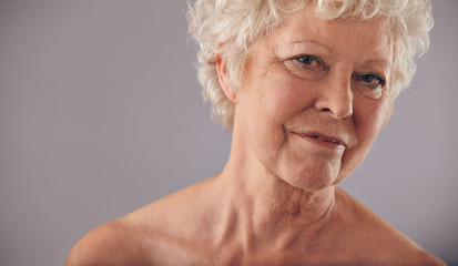 Old woman with wrinkled skin
