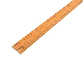 Close up photo of a wooden meteric ruler on a white dackground.