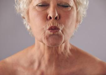 Senior woman puckering lips