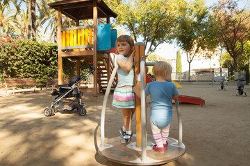 girls  playing in playground area