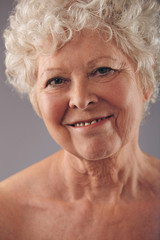 Attractive senior woman face with a sweet smile