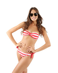 Beautiful young woman in striped swimsuit isolated on white