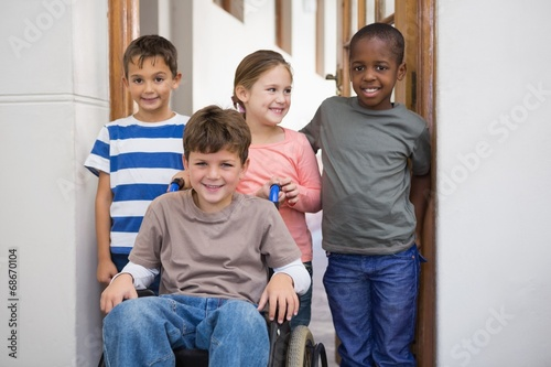 Disabled pupil with his friends in classroom - 68670104