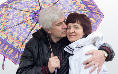 Man and woman with an umbrella
