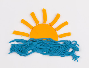 Sun from children bright plasticine