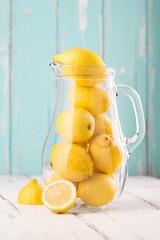 Lemonade. Fresh lemons in the jar.