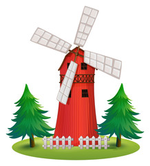 A tall wooden building with a windmill