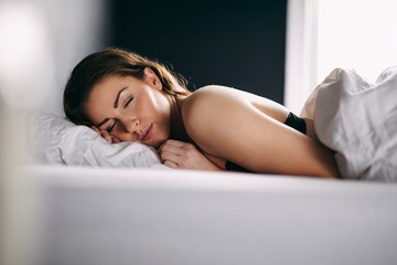 Young woman sleeping peacefully in her bed