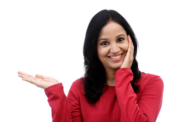 Smiling young woman showing isolated presentation