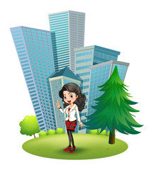 A woman outside the big buildings