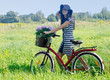 Happy  woman cycling on a  meadow