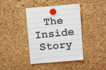 The phrase The Inside Story on a cork notice board