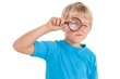 Cute little boy looking through magnifying glass - 68672300