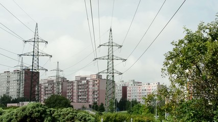 housing estate with high voltage and trees