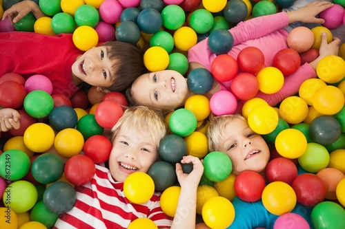 Happy children playing in ball pool - 68672349