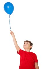 Happy little boy holding blue balloon